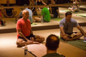 Russell Simmons sharing success practices on the mat